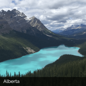 Alberta landscape with turquoise lake and mountains.