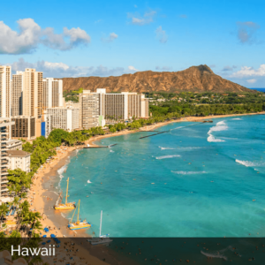 Hawaii coast with high rise buildings and mountain in the background