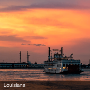 Louisiana sunset on the water with paddleboat