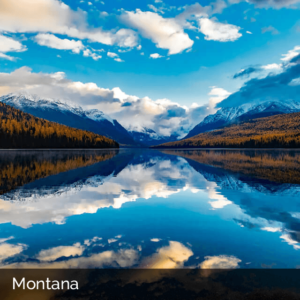 Montana lake with mountains and blue sky in the background