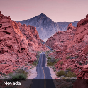 Nevada road winding through red mountains